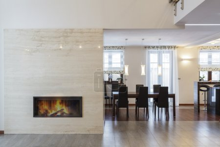 Grand design - Fireplace in living room and table...