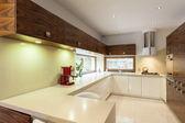 Kitchen with wooden furniture
