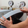Repairing water softener, plumber with a wrench...