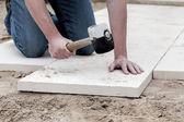 Installation of paving slabs