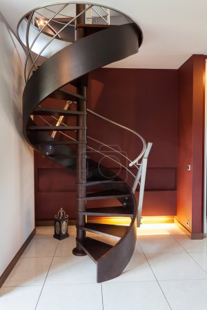 Photo for Spiral wooden staircase in a modern luxury house - Royalty Free Image