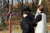 Two women at cemetery in fall