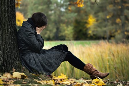 Photo for Young woman having autumn depression and crying - Royalty Free Image