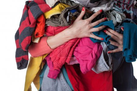 Photo for Woman holding a huge pile of clothes - Royalty Free Image