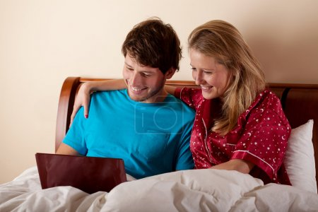 Couple watching the movie in bed