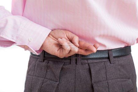 Photo pour Un gros plan de la main de l'homme, faisant un geste de malhonnêteté - image libre de droit
