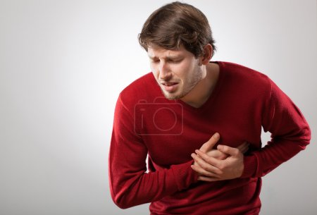 Photo for Young athletic man has a sudden heart attack - Royalty Free Image