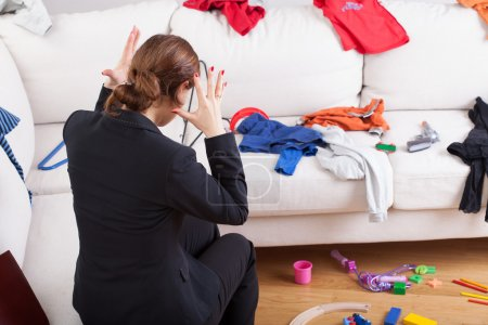 Photo for Young active woman can't stand a big mess what she has seen at home - Royalty Free Image