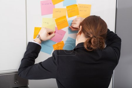 Woman is exhausted of too much daily tasks