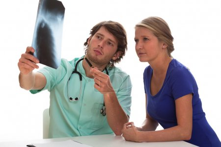 Doctor and patient watching a picture of lungs