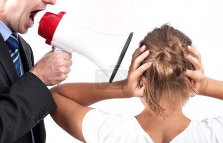 Photo for Businessman is yelling through a megaphone, his victim is also his employee - Royalty Free Image