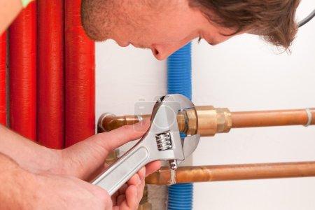 Handyman using wrench