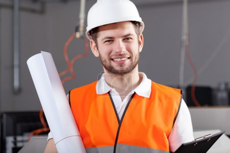Engineer in warehouse with project