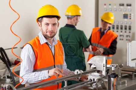 Photo for Male production workers working during production process - Royalty Free Image