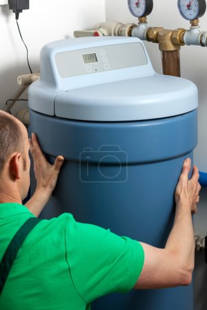 Instalation of a water softener in boiler room...
