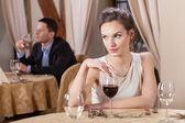 """Постер, картина, фотообои """"Женщина пьет вино в ресторане"""""""