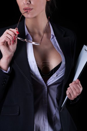 Businesswoman with unbuttoned shirt