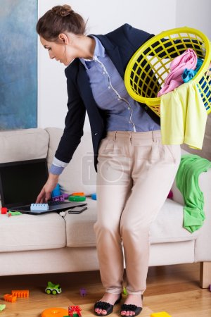 Businesswoman doing housework