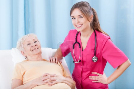 Photo for Elderly lady and her smiling doctor, horizontal - Royalty Free Image