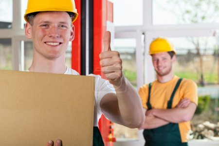 Worker showing thumbs up sign