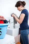 Housekeeper washing clothes