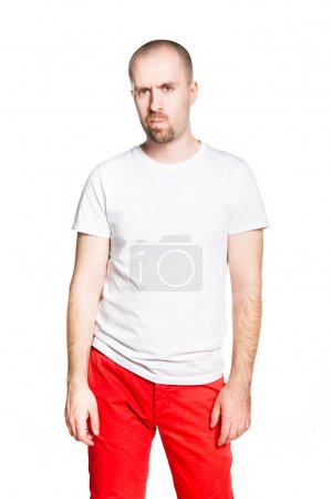 Disappointed handsome man in white t-shirt isolated on white