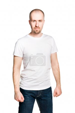 Attractive man with clenched fists in white t-shirt and blue jeans isolated on white