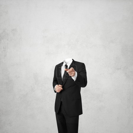 business man without a head on white concrete background