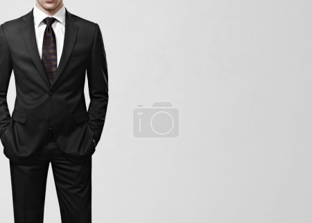 Photo for Man in suit on a gray background - Royalty Free Image