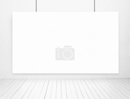 White room with poster on wall