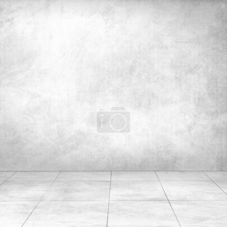 white concrete wall and ceramic tile floor