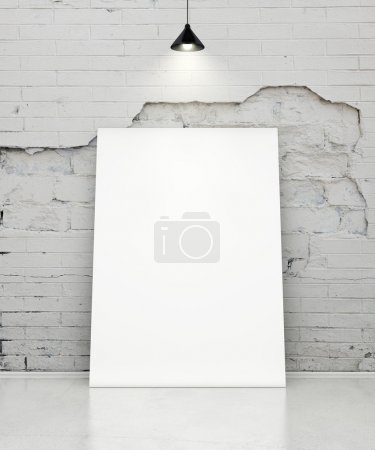 White poster on grunge wall with lamp.