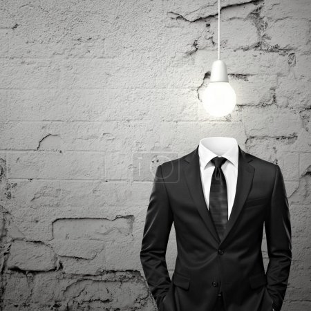 Photo for Man without head and with bulb above - Royalty Free Image
