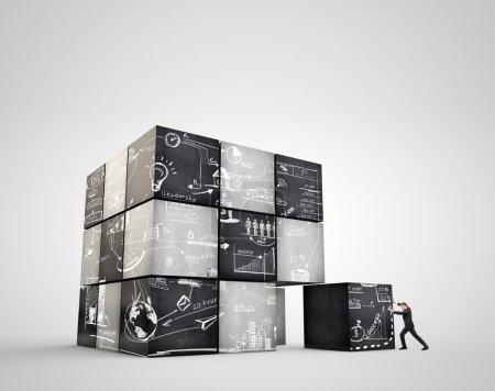 The geometrical image cubes with business strategy. Businessman moves an enormous weight