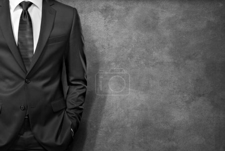 Photo for Man in the suit on concrete background - Royalty Free Image