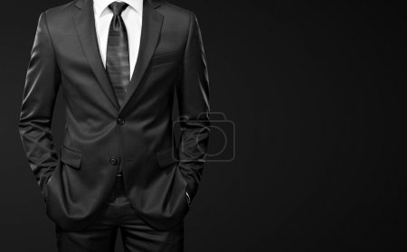 Photo for Man in the suit on black - Royalty Free Image