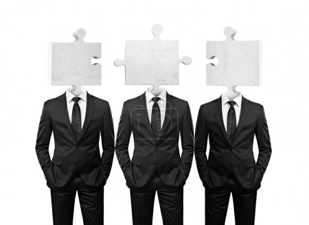 Team of businessman with puzzle pieces instead heads