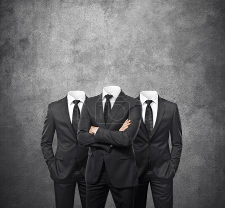 Photo for Group of businessmen without heads on concrete background - Royalty Free Image