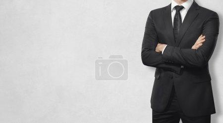 Photo pour Homme en costume sur fond blanc - image libre de droit