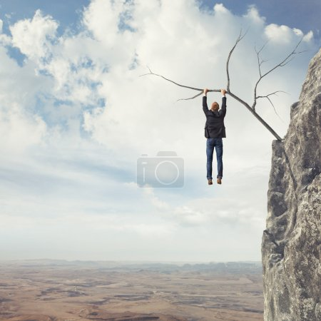 Photo for Business man climbs a mountain - Royalty Free Image