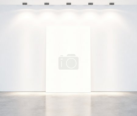 Photo for Empty white wall with halogen lamp light over blank frame - Royalty Free Image