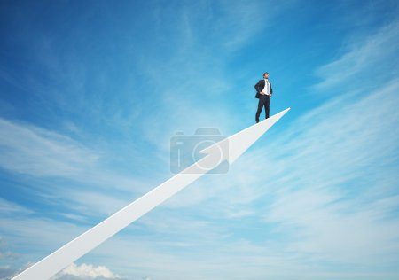 Photo for Businessman on  arrow in sky - Royalty Free Image