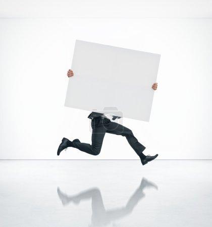 Running business man holding poster