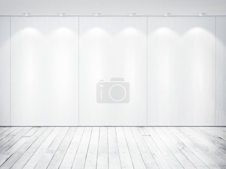 White wall with lamps, wood floor