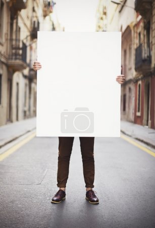 Photo for Man holding blank poster - Royalty Free Image
