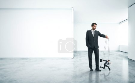Businessman with marionette