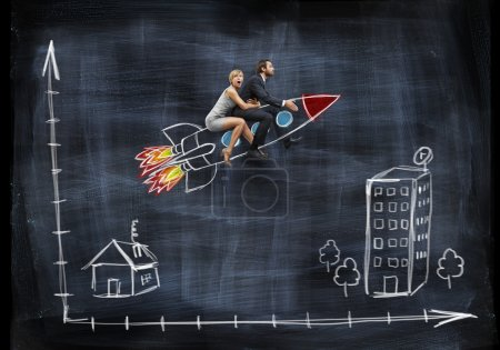 Businessman and businesswoman flying with rocket
