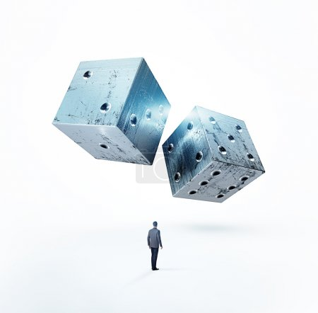 Businessman with metal dices