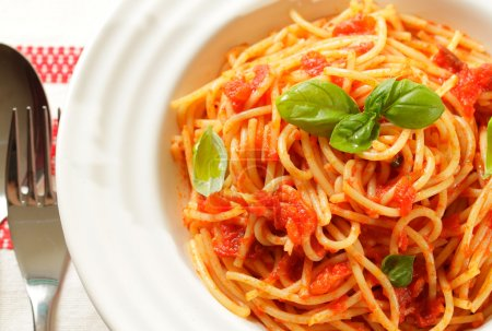 Photo for Spaghetti with tomato sauce and basil in white plate - Royalty Free Image