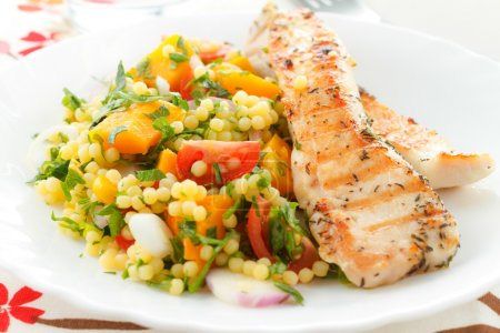 Photo for Spicy grilled chicken with fresh vegetables and couscous - Royalty Free Image